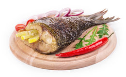 Grilled carp with peppers. Stock Photography