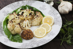 Grilled cauliflower. Served with lemon slices and herbs Royalty Free Stock Image