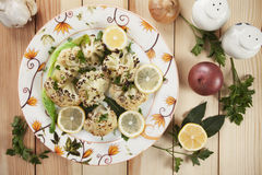 Grilled cauliflower. Served with lemon slices and herbs Royalty Free Stock Images