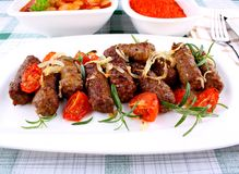 Grilled cevapcici with ajvar and giant white beans Stock Photography
