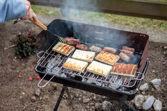 Grilled cevapcici and cheese balkan cuisine Royalty Free Stock Image
