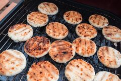 Grilled cheese arepas, made with cornmeal and cheese. Popular dish from Colombia