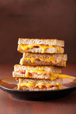 Grilled cheese and bacon sandwich Stock Photos