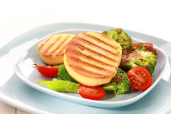 Grilled cheese on grilled vegetables Royalty Free Stock Images