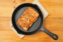 Grilled cheese sandwich in cast iron skillet. A grilled cheese sandwich in a cast iron skillet photographed from above Royalty Free Stock Photos