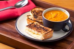 Grilled cheese sandwich and soup Royalty Free Stock Photography