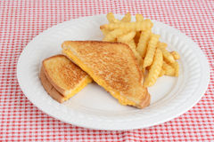 Grilled cheese sandwich with french fries Royalty Free Stock Photography