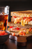 Grilled cheese sandwich with ham and tomato Royalty Free Stock Images