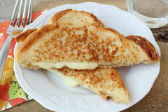 Grilled cheese sandwich made with cheddar. On a white plate Stock Images