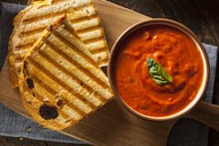 Grilled Cheese Sandwich with Tomato Soup. Grilled Cheese Sandwich with Creamy Tomato Basil Soup Royalty Free Stock Images