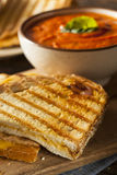 Grilled Cheese Sandwich with Tomato Soup. Grilled Cheese Sandwich with Creamy Tomato Basil Soup Stock Photo
