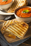 Grilled Cheese Sandwich with Tomato Soup. Grilled Cheese Sandwich with Creamy Tomato Basil Soup Royalty Free Stock Photos