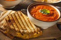 Grilled Cheese Sandwich with Tomato Soup. Grilled Cheese Sandwich with Creamy Tomato Basil Soup Stock Photos