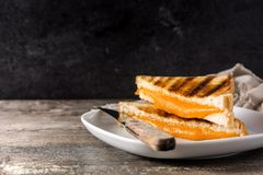 Grilled cheese sandwich on wood royalty free stock photos