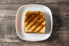 Grilled cheese sandwich on wood stock images