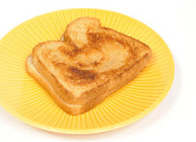 Grilled cheese sandwich. On a yellow striped plate royalty free stock photography
