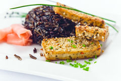Grilled cheese tofu with black rice Stock Photo