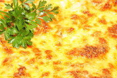 Grilled cheese topping with parsley - background Royalty Free Stock Image