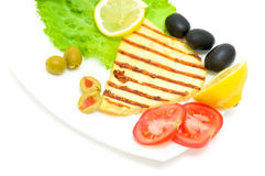 Grilled cheese with vegetables on the plate Stock Photo