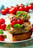 Grilled cherry tomato turkey burgers. Style rustic .selective focus Royalty Free Stock Images