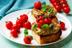 Grilled cherry tomato turkey burgers. Style rustic .selective focus Royalty Free Stock Image