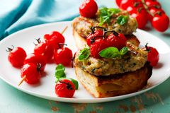 Grilled cherry tomato turkey burgers. Style rustic .selective focus Royalty Free Stock Photography