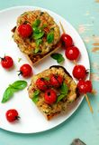Grilled cherry tomato turkey burgers Stock Photography