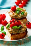 Grilled cherry tomato turkey burgers. Style rustic .selective focus Stock Images