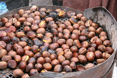 Grilled chestnut. Grilling chestnuts in Budapest Royalty Free Stock Images