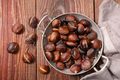 Grilled chestnut. On wood background royalty free stock photo