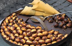 Grilled chestnuts stock photos