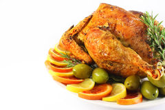 Grilled chicken. Roast chicken with olives, orange, lemon and rosemary Royalty Free Stock Photo
