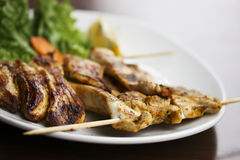 Grilled chicken. On skewers with salad royalty free stock image