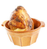Grilled chicken. Whole roasted chicken in  pottery  for frying isolated on white background Stock Photography