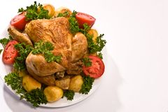 Grilled chicken. Food series: grilled chicken with tomatoes and potatoes royalty free stock photos