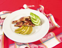 Grilled chicken with apples. Grilled chicken stripes fajitas with apple stock photography