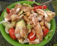 Grilled chicken and avacado summer salad with balsamic dressing stock photos