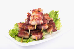 Grilled chicken with bacon Stock Images
