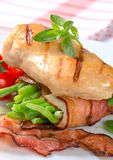Grilled chicken with bacon-wrapped green beans Royalty Free Stock Photo