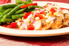 Grilled Chicken with Beans Stock Photos