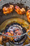 Grilled chicken(in big jar) selling in the local market of Thail Stock Photography
