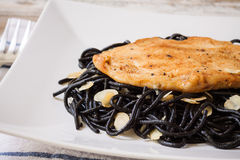 Grilled chicken with black spaghetti Stock Photography
