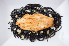 Grilled chicken with black spaghetti Royalty Free Stock Images