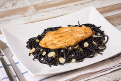 Grilled chicken with black spaghetti Royalty Free Stock Image