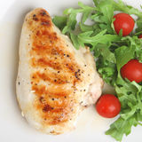 Grilled Chicken Breast. Grilled seasoned chicken breast with rocket salad Stock Photo