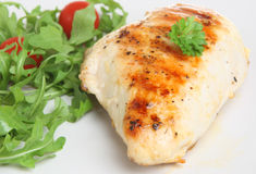 Grilled Chicken Breast. With rocket and tomato salad Stock Image