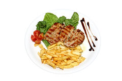 Grilled Chicken Breast. Fresh chicken breast served with french fries isolated on a white background Royalty Free Stock Image