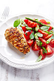 Grilled Chicken Breast with Asparagus and Cherry Tomato Salad with Herbs and Chia Seeds royalty free stock images
