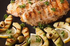 Grilled chicken breast with avocado, lemon and olive macro. Hori Stock Photography