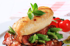 Grilled chicken breast with bacon-wrapped green beans Royalty Free Stock Image
